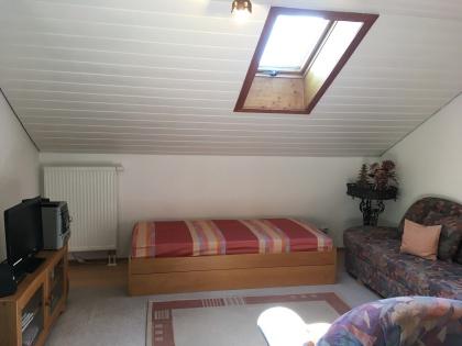 Einzelbett für dritte Person